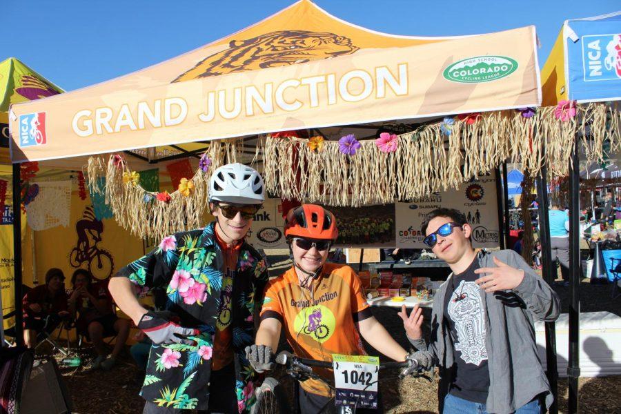 Paul+English%2C+junior%2C+Mia+Brygger%2C+junior%2C+and+Miles+Willis%2C+junior%2C+pose+outside+of+the+Hawaiian+decorated+team+tent+before+their+race+in+Durango+Colorado.