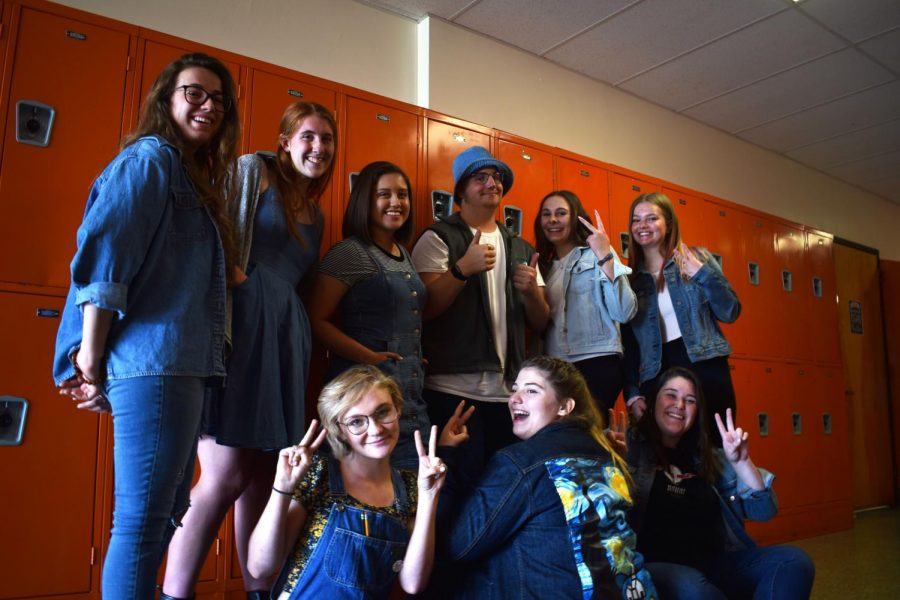 A+group+of+seniors+pose+for+the+camera+to+show+off+their+denim+outfits+on+denim+day+spirit+week.+
