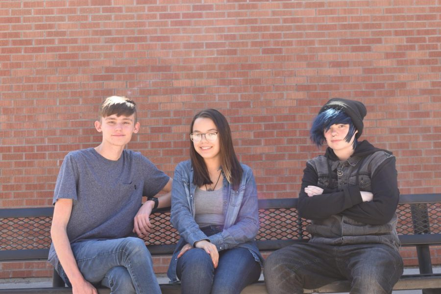 (From left to right) Liam Richardson (senior), Alexandria Canela (junior), Tristan Frech (junior). Three of Mr. Browns students sit on a bench wearing their denim outfits on denim day during homecoming spirit week.