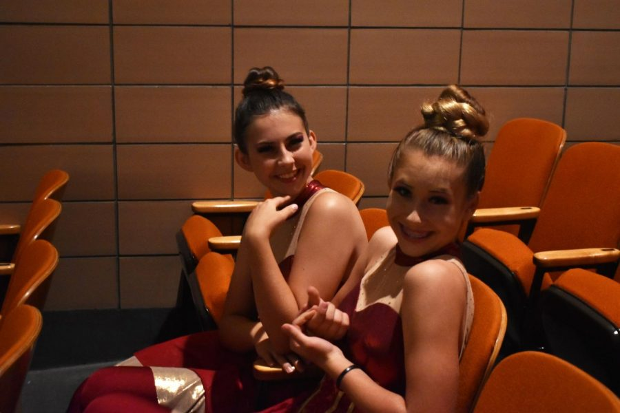 (From left to right) Mckenna Bryant and Maddie Hawks sit in the auditorium before their performance at the 2019 preview concert.