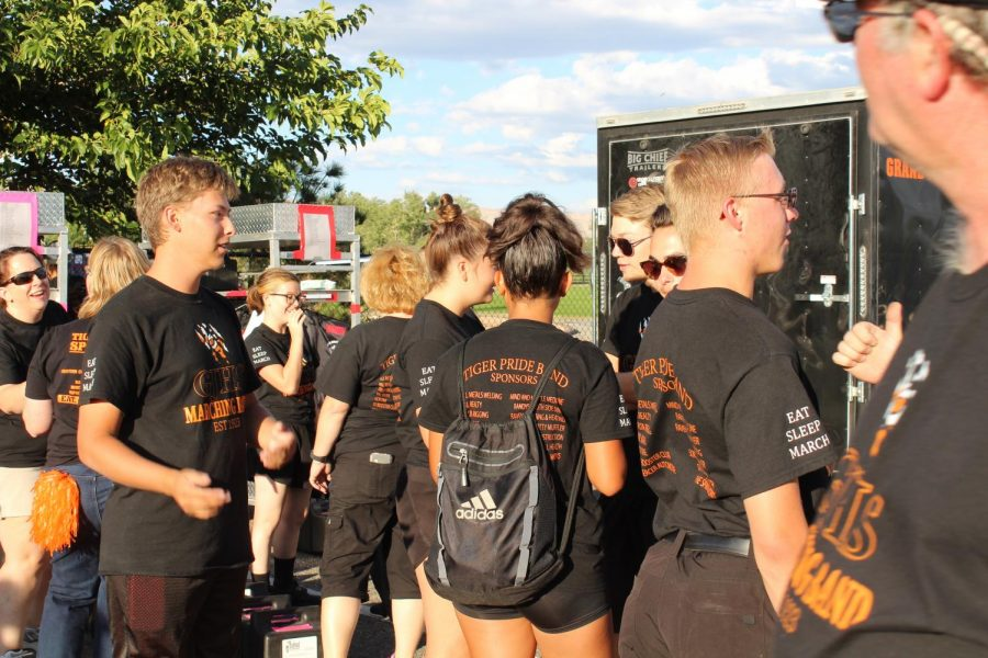 GJHS Marching Band members report to Lincoln Park, soon to get into uniform.