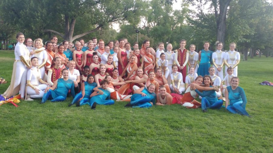 Color guard members from all four HS marching bands meet and greet after warm-ups.