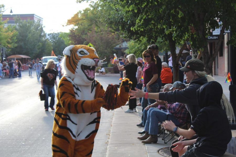 The GJHS mascot makes friends with the crowd.