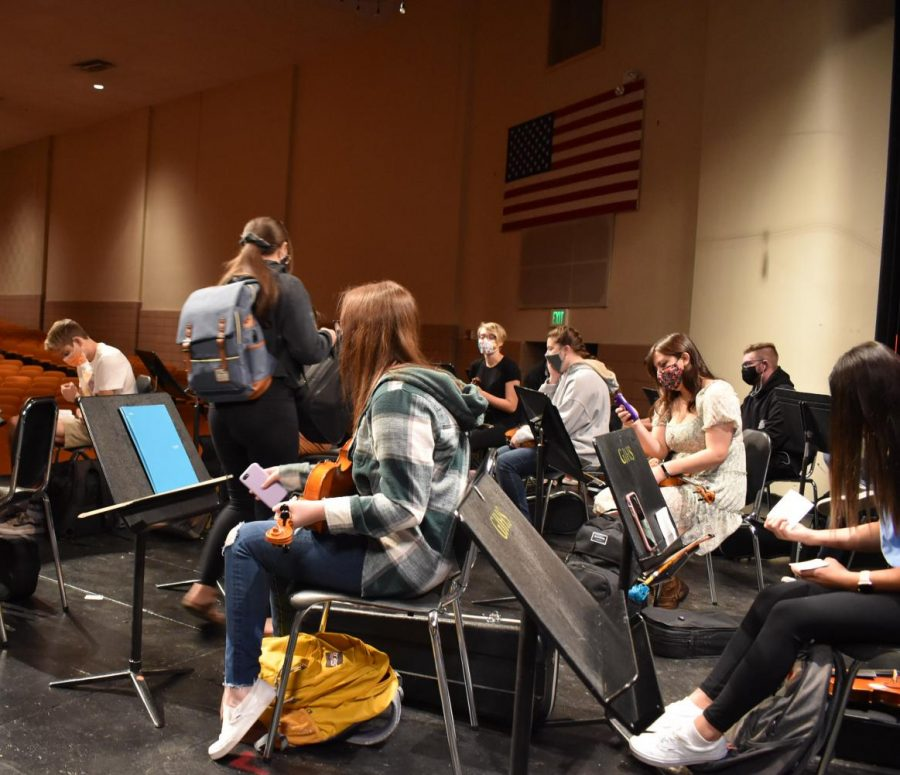 Orchestra students practice on stage for the upcoming preview concert.
