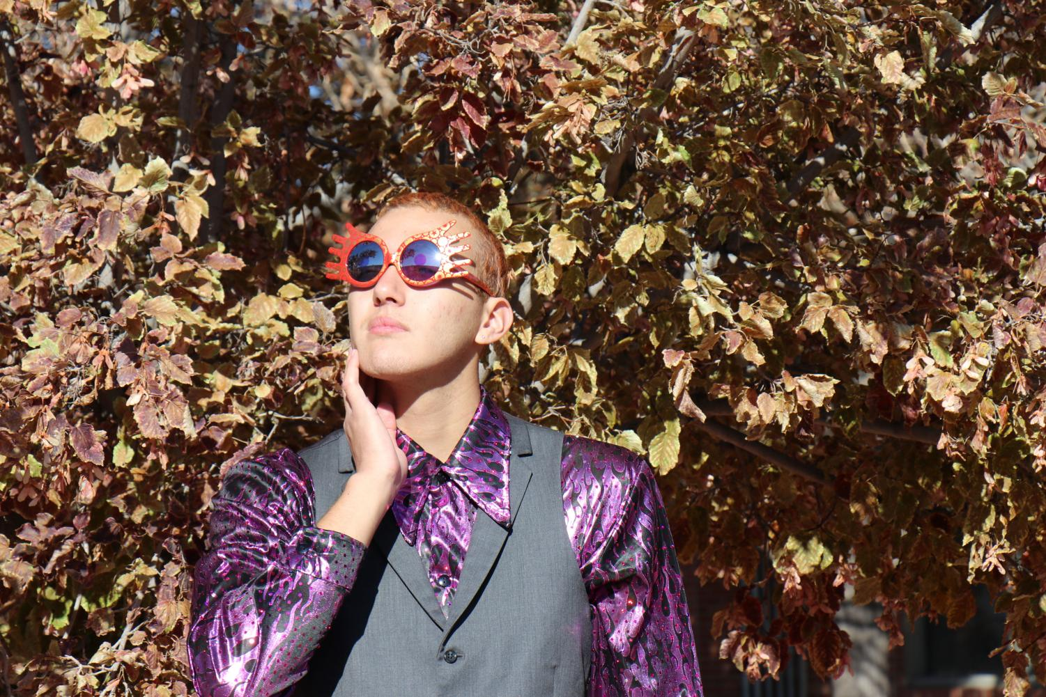 """His fashion is inspired by Elton John's colorful, outrageous clothes that make a statement about himself and consults with Raine Foor, a close friend and fellow fashionista. """"I want people to see me as me and I want to express myself and be colorful and vibrant...I don't need to be a different person to be confident in myself,"""" DeCrow said."""